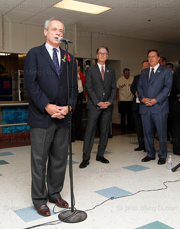BOSTON -- Boston Red Sox president and CEO Larry Lucchino, left, speaks to Red Sox alumni as principal owner John Henry, center, and chairman Tom Werner listen at Fenway High School prior to the special pregame ceremony celebrating the 100th anniversary of Fenway Park on Friday, April 20, 2012. (Brita Meng Outzen/Boston Red Sox)