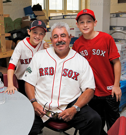 BOSTON -- Former Boston Red Sox pitcher and bullpen coach Al Nipper, center, poses at Fenway High School prior to the special pregame ceremony celebrating the 100th anniversary of Fenway Park on Friday, April 20, 2012. (Brita Meng Outzen/Boston Red Sox)