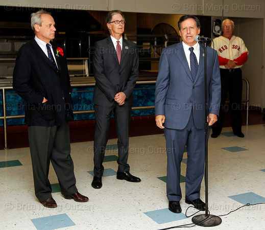BOSTON -- Boston Red Sox chairman Tom Werner, right, speaks to alumni as Red Sox president and CEO Larry Lucchino, left, and principal owner John Henry listen at Fenway High School prior to the special pregame ceremony celebrating the 100th anniversary of Fenway Park on Friday, April 20, 2012. (Brita Meng Outzen/Boston Red Sox)