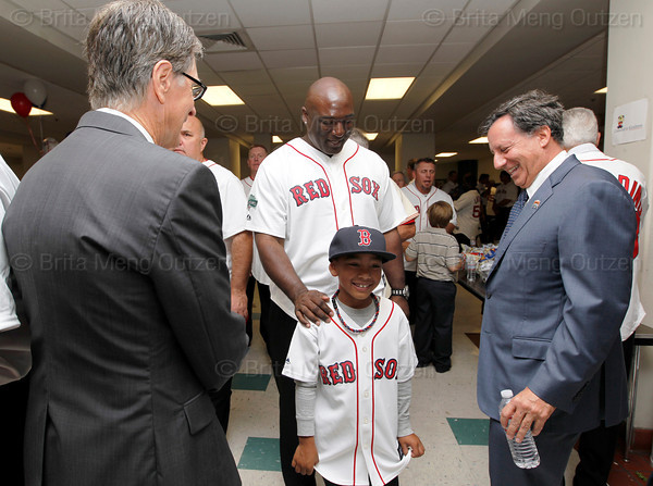 BOSTON -- Boston Red Sox principal owner John Henry, left, and chairman Tom Werner, right, share a laugh with Red Sox alumnus Calvin Pickering and his son at Fenway High School prior to the special pregame ceremony celebrating the 100th anniversary of Fenway Park on Friday, April 20, 2012. (Brita Meng Outzen/Boston Red Sox)
