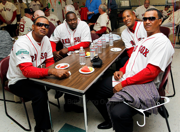 BOSTON -- From left, Boston Red Sox alumni Izzy Alcantara, Anastacio Martinez, Josias Manzanillo and Wilton Veras -- all from the Dominican Republic -- gather at Fenway High School prior to the special pregame ceremony celebrating the 100th anniversary of Fenway Park on Friday, April 20, 2012. (Brita Meng Outzen/Boston Red Sox)