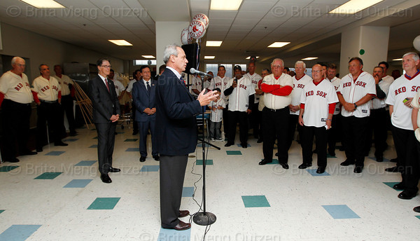 BOSTON -- Boston Red Sox alumni, Red Sox principal owner John Henry, fourth from left, and chairman Tom Werner, fifth from left, listen as Red Sox president and CEO Larry Lucchino, center, speaks at Fenway High School prior to the special pregame ceremony celebrating the 100th anniversary of Fenway Park on Friday, April 20, 2012. (Brita Meng Outzen/Boston Red Sox)