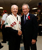 BOSTON -- Boston Red Sox president and CEO Larry Lucchino, right, shakes hands with a Red Sox alumnus at Fenway High School prior to the special pregame ceremony celebrating the 100th anniversary of Fenway Park on Friday, April 20, 2012. (Brita Meng Outzen/Boston Red Sox)