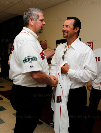 BOSTON -- Former Boston Red Sox pitcher Tim Wakefield, right, is greeted by fellow alumnus Steve Crawford at Fenway High School prior to the special pregame ceremony celebrating the 100th anniversary of Fenway Park on Friday, April 20, 2012. (Brita Meng Outzen/Boston Red Sox)
