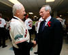 BOSTON -- Boston Red Sox president and CEO Larry Lucchino, right, chats with a Red Sox alumnus at Fenway High School prior to the special pregame ceremony celebrating the 100th anniversary of Fenway Park on Friday, April 20, 2012. (Brita Meng Outzen/Boston Red Sox)