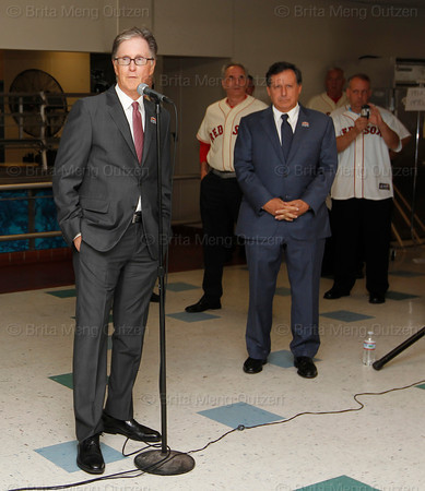 BOSTON -- Boston Red Sox principal owner John Henry, left, speaks to Red Sox alumni gathered at Fenway High School prior to the special pregame ceremony celebrating the 100th anniversary of Fenway Park on Friday, April 20, 2012. Red Sox chairman Tom Werner is at right. (Brita Meng Outzen/Boston Red Sox)