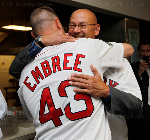 BOSTON -- Former Boston Red Sox manager Terry Francona, right, hugs former pitcher Alan Embree at Fenway High School prior to the special pregame ceremony celebrating the 100th anniversary of Fenway Park on Friday, April 20, 2012. (Brita Meng Outzen/Boston Red Sox)
