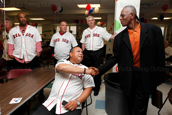 "BOSTON -- Former Boston Red Sox pitcher Dennis ""Oil Can"" Boyd, right, shakes hands with fellow alumnus Carlos Baerga at Fenway High School prior to the special pregame ceremony celebrating the 100th anniversary of Fenway Park on Friday, April 20, 2012. (Brita Meng Outzen/Boston Red Sox)"