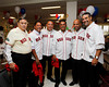 BOSTON -- From left, Boston Red Sox alumni Jose Santiago, Luis Alicea, Carlos Baerga, Ed Romero, Alex Cora and Mike Lowell -- all from Puerto Rico -- gather at Fenway High School prior to the special pregame ceremony celebrating the 100th anniversary of Fenway Park on Friday, April 20, 2012. (Brita Meng Outzen/Boston Red Sox)