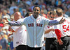 BOSTON -- Former Boston Red Sox pitcher Pedro Martinez gestures to fellow Red Sox alumni on the field during the special pregame ceremony celebrating the 100th anniversary of Fenway Park on Friday, April 20, 2012. (Brita Meng Outzen/Boston Red Sox)