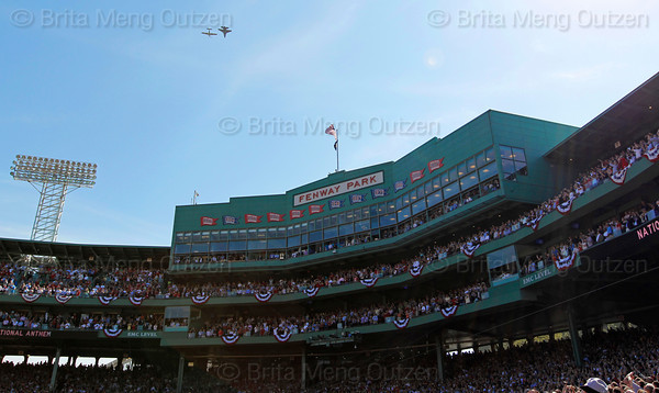 BOSTON -- A two-ship Air Force Heritage Flight, which features a modern F-15 jet in formation with a vintage World War II-era P-51 Mustang, flies over Fenway Park following the National Anthem during the special pregame ceremony celebrating the 100th anniversary of Fenway Park on Friday, April 20, 2012. (Brita Meng Outzen/Boston Red Sox)