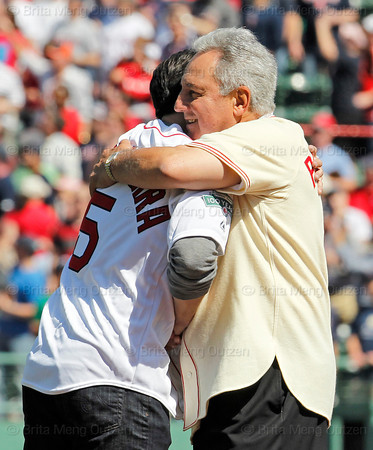 BOSTON -- Fellow Boston Red Sox alumni Nomar Garciaparra, left, and Rico Petrocelli share a hug on the field during the special pregame ceremony celebrating the 100th anniversary of Fenway Park on Friday, April 20, 2012. (Brita Meng Outzen/Boston Red Sox)