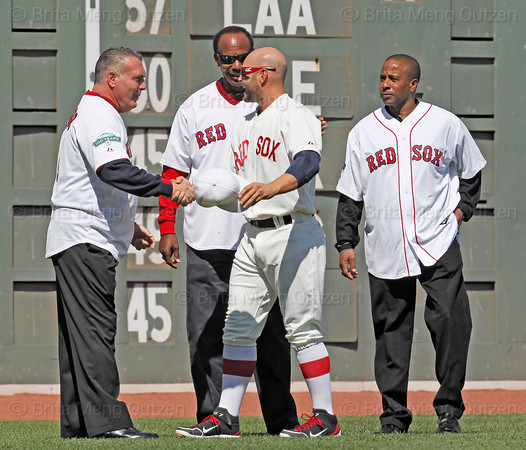 BOSTON -- Boston Red Sox outfielder Cody Ross, second from right, shakes hands with Red Sox alumnus Bernie Carbo in left field during the special pregame ceremony celebrating the 100th anniversary of Fenway Park on Friday, April 20, 2012. (Brita Meng Outzen/Boston Red Sox)