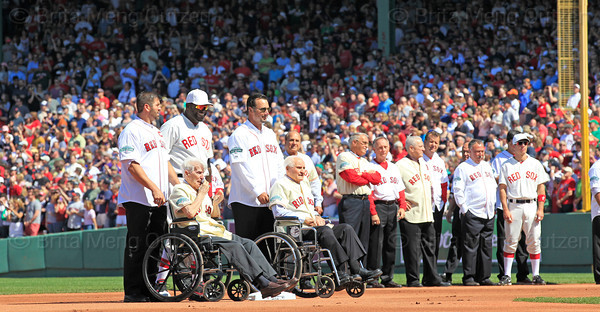 BOSTON -- Boston Red Sox alumnus Johnny Pesky, second from left, wipes away a tear as fellow alumni Jason Varitek, left, Tim Wakefield, second from right, and Bobby Doerr, right, and current Boston Red Sox designated hitter David Ortiz watch during the special pregame ceremony celebrating the 100th anniversary of Fenway Park on Friday, April 20, 2012. (Brita Meng Outzen/Boston Red Sox)
