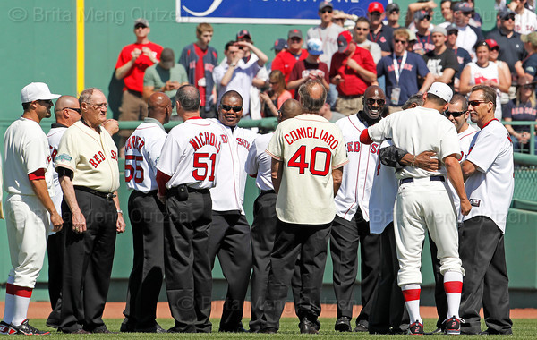 BOSTON -- Boston Red Sox center fielder Jacoby Ellsbury, third from right, and outfielder Jason Repko, left, stand on the field with alumni center fielders during the special pregame ceremony celebrating the 100th anniversary of Fenway Park on Friday, April 20, 2012. (Brita Meng Outzen/Boston Red Sox)