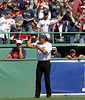 BOSTON -- Former Boston Red Sox player Jose Canseco flexes in front of the bullpen after walking onto the field during the special pregame ceremony celebrating the 100th anniversary of Fenway Park on Friday, April 20, 2012. (Brita Meng Outzen/Boston Red Sox)