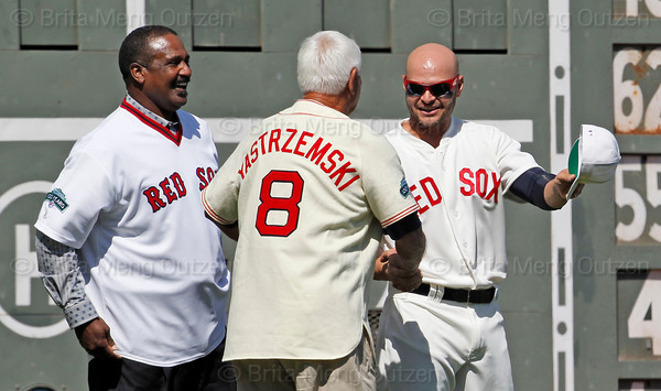 BOSTON -- Boston Red Sox outfielder Cody Ross, right, chats with Red Sox alumni and Hall of Famers Carl Yastrzemski, center, and Jim Rice on the field during the special pregame ceremony celebrating the 100th anniversary of Fenway Park on Friday, April 20, 2012. (Brita Meng Outzen/Boston Red Sox)