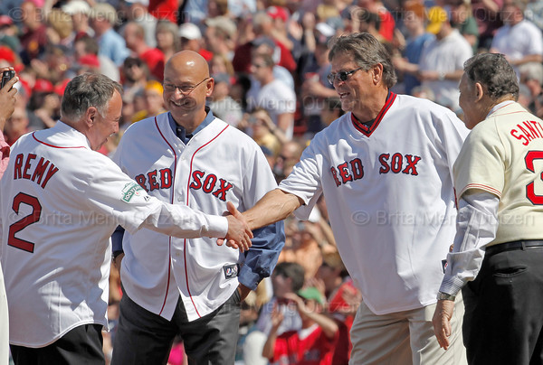 BOSTON -- From left, Boston Red Sox alumni Jerry Remy, Terry Francona, Carlton Fisk and Jose Santiago greet each other on the field during a pregame ceremony celebrating the 100th anniversary of Fenway Park on Friday, April 20, 2012. (Brita Meng Outzen/Boston Red Sox)