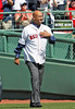 BOSTON -- Former Boston Red Sox manager Terry Francona touches his heart to acknowledge the fan ovation as he walks onto the field during the special pregame ceremony celebrating the 100th anniversary of Fenway Park on Friday, April 20, 2012. (Brita Meng Outzen/Boston Red Sox)