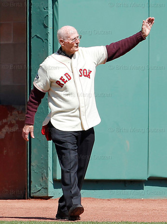 BOSTON -- Former Boston Red Sox pitcher Bill Monbouquette waves to the fans as he walks onto the field during the special pregame ceremony celebrating the 100th anniversary of Fenway Park on Friday, April 20, 2012. (Brita Meng Outzen/Boston Red Sox)