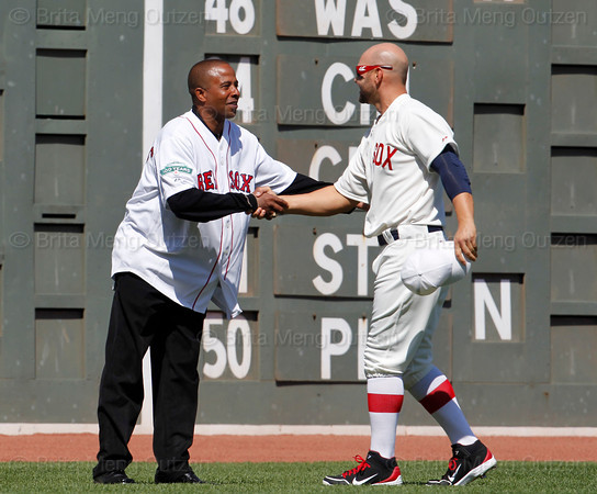 BOSTON -- Boston Red Sox outfielder Cody Ross, right, greets a Red Sox alumnus in left field during the special pregame ceremony celebrating the 100th anniversary of Fenway Park on Friday, April 20, 2012. (Brita Meng Outzen/Boston Red Sox)