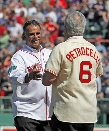 BOSTON -- Former Boston Red Sox players Rico Petrocelli, right, and Ed Romero greet each other on the field during the special pregame ceremony celebrating the 100th anniversary of Fenway Park on Friday, April 20, 2012. (Brita Meng Outzen/Boston Red Sox)