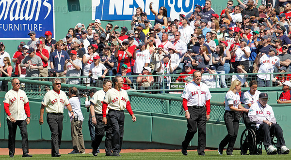 BOSTON -- Boston Red Sox alumni walk onto the field during the special pregame ceremony celebrating the 100th anniversary of Fenway Park on Friday, April 20, 2012. (Brita Meng Outzen/Boston Red Sox)