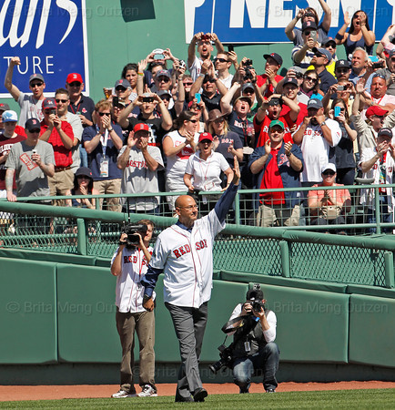 BOSTON -- Former Boston Red Sox manager Terry Francona acknowledges the fan ovation as he walks onto the field during the special pregame ceremony celebrating the 100th anniversary of Fenway Park on Friday, April 20, 2012. (Brita Meng Outzen/Boston Red Sox)