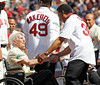 BOSTON -- Former Boston Red Sox pitcher Diego Segui, right, greets fellow alumnus Johnny Pesky on the field during the special pregame ceremony celebrating the 100th anniversary of Fenway Park on Friday, April 20, 2012. (Brita Meng Outzen/Boston Red Sox)