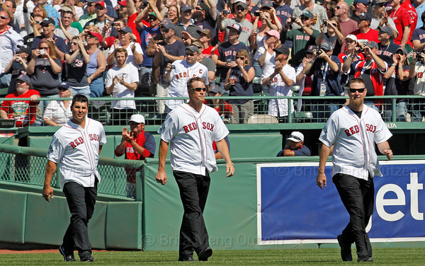 BOSTON -- From left, former Boston Red Sox pitchers Keith Foulke, Mike Timlin and Alan Embree walk onto the field during the special pregame ceremony celebrating the 100th anniversary of Fenway Park on Friday, April 20, 2012. (Brita Meng Outzen/Boston Red Sox)
