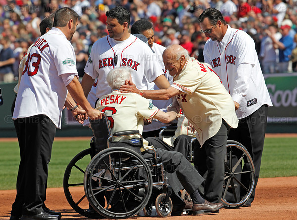 BOSTON -- Former Boston Red Sox player Johnny Pesky, center, gets an affectionate pat on the cheek from fellow alumnus Frank Malzone at the end of the special pregame ceremony celebrating the 100th anniversary of Fenway Park on Friday, April 20, 2012. (Brita Meng Outzen/Boston Red Sox)