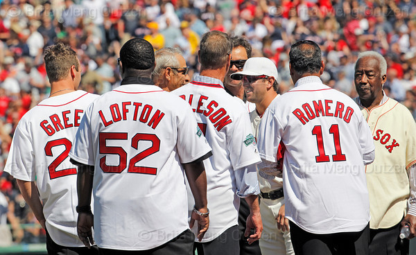 BOSTON -- Boston Red Sox infielder Nick Punto, third from right, greets Red Sox shortstop alumni on the field during the special pregame ceremony celebrating the 100th anniversary of Fenway Park on Friday, April 20, 2012.  (Brita Meng Outzen/Boston Red Sox)