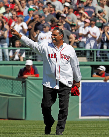 BOSTON -- Former Boston Red Sox infielder Ed Romero waves as he walks to his position during the special pregame ceremony celebrating the 100th anniversary of Fenway Park on Friday, April 20, 2012. (Brita Meng Outzen/Boston Red Sox)