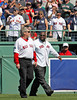 BOSTON -- Boston Red Sox alumni, including former first baseman Mo Vaughn, right, walk onto the field during the special pregame ceremony celebrating the 100th anniversary of Fenway Park on Friday, April 20, 2012. (Brita Meng Outzen/Boston Red Sox)