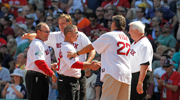 BOSTON -- Former Boston Red Sox catchers, including Rich Gedman, Gary Allenson, Carlton Fisk and Bob Montgomery greet each other on the field during the special pregame ceremony celebrating the 100th anniversary of Fenway Park on Friday, April 20, 2012. (Brita Meng Outzen/Boston Red Sox)