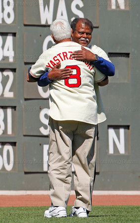 BOSTON -- Former Boston Red Sox left fielder and Hall of Famer Carl Yastrzemski, left, and fellow Red Sox alumnus Reggie Smith hug on the field during the special pregame ceremony celebrating the 100th anniversary of Fenway Park on Friday, April 20, 2012. (Brita Meng Outzen/Boston Red Sox)