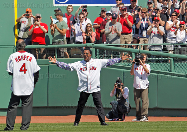 BOSTON -- Former Boston Red Sox pitcher Pedro Martinez, second from left, has an enthusiastic greeting for fellow Red Sox alumnus Tommy Harper on the field during the special pregame ceremony celebrating the 100th anniversary of Fenway Park on Friday, April 20, 2012. (Brita Meng Outzen/Boston Red Sox)