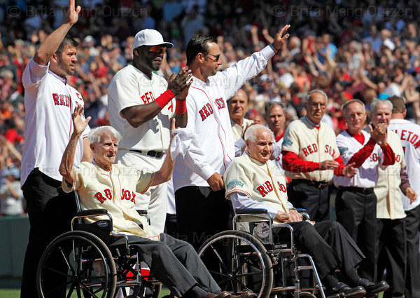 BOSTON -- Current Boston Red Sox player David Ortiz, third from left, applauds as from left, former Boston Red Sox players Jason Varitek, Johnny Pesky, Tim Wakefield and Bobby Doerr wave to fans as they are introduced during the special pregame ceremony celebrating the 100th anniversary of Fenway Park on Friday, April 20, 2012. (Brita Meng Outzen/Boston Red Sox)