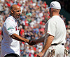 BOSTON -- Boston Red Sox third baseman Kevin Youkilis, right, greets former teammate and Red Sox alumnus Alex Cora on the field during the special pregame ceremony celebrating the 100th anniversary of Fenway Park on Friday, April 20, 2012. (Brita Meng Outzen/Boston Red Sox)