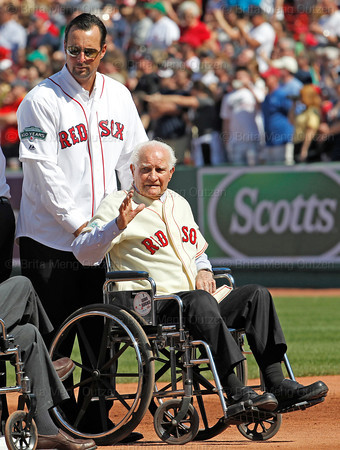 BOSTON -- Former Boston Red Sox second baseman and Hall of Famer Bobby Doerr, right, waves to fans as he prepares to leave the field assisted by former Red Sox pitcher Tim Wakefield at the end of a special pregame ceremony celebrating Fenway Park's 100th anniversary on Friday, April 20, 2012. (Brita Meng Outzen/Boston Red Sox)