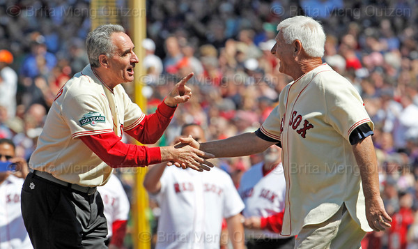 BOSTON -- Former Boston Red Sox left fielder and Hall of Famer Carl Yastrzemski, right, gets a greeting from a fellow Red Sox alumnus on the field during the special pregame ceremony celebrating the 100th anniversary of Fenway Park on Friday, April 20, 2012. (Brita Meng Outzen/Boston Red Sox)