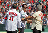 BOSTON -- Former Boston Red Sox shortstop Nomar Garciaparra, center, is greeted by fellow alumni Rico Petrocelli, right, and Ed Romero on the field during the special pregame ceremony celebrating the 100th anniversary of Fenway Park on Friday, April 20, 2012. (Brita Meng Outzen/Boston Red Sox)