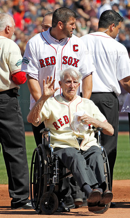 BOSTON -- Former Boston Red Sox shortstop Johnny Pesky, bottom, waves to fans as he prepares to leave the field with the assistance of former Red Sox catcher Jason Varitek at the end of a special pregame ceremony celebrating Fenway Park's 100th anniversary on Friday, April 20, 2012. (Brita Meng Outzen/Boston Red Sox)