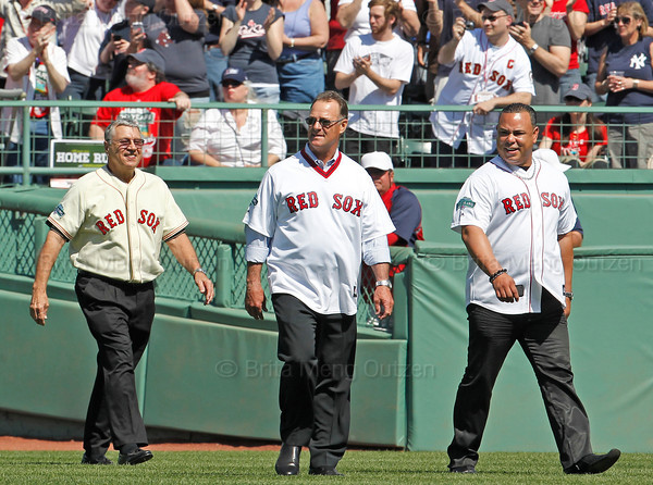BOSTON -- Boston Red Sox alumni wear uniforms the same style they wore when playing for the team as they walk onto the field during the special pregame ceremony celebrating the 100th anniversary of Fenway Park on Friday, April 20, 2012. (Brita Meng Outzen/Boston Red Sox)