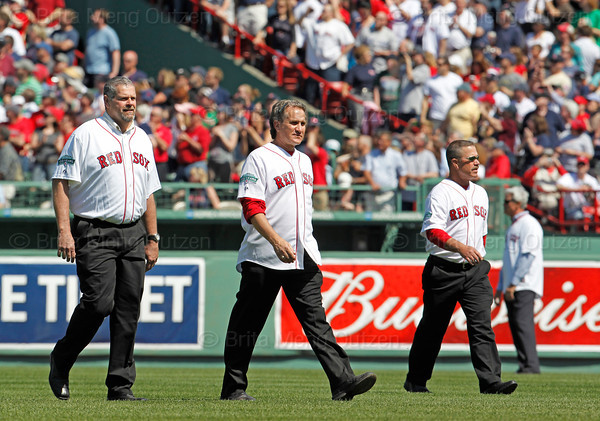 BOSTON -- Former Boston Red Sox players, from left, Steve Crawford, Joe Sambito and Gary Allenson walk onto the field during the special pregame ceremony celebrating the 100th anniversary of Fenway Park on Friday, April 20, 2012. (Brita Meng Outzen/Boston Red Sox)