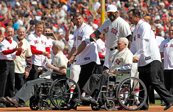 BOSTON -- Former Boston Red Sox shortstop Johnny Pesky, left, and former Red Sox second baseman and Hall of Famer Bobby Doerr, second from right, are accompanied onto the field by recently retired Red Sox catcher Jason Varitek, second from left, David Ortiz and recently retired Red Sox pitcher Tim Wakefield during the special pregame ceremony celebrating the 100th anniversary of Fenway Park on Friday, April 20, 2012. (Brita Meng Outzen/Boston Red Sox)