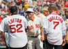 BOSTON -- Boston Red Sox infielder Nick Punto, center, greets former Red Sox players James Lofton, left, and Rick Burleson on the field during the special pregame ceremony celebrating the 100th anniversary of Fenway Park on Friday, April 20, 2012. (Brita Meng Outzen/Boston Red Sox)