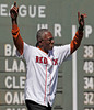 "BOSTON -- Former Boston Red Sox pitcher Dennis ""Oil Can"" Boyd raises his arms in triumph while walking to his position on the field during the special pregame ceremony celebrating the 100th anniversary of Fenway Park on Friday, April 20, 2012. (Brita Meng Outzen/Boston Red Sox)"