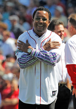 BOSTON -- Former Boston Red Sox pitcher Pedro Martinez gestures a hug to fellow Red Sox alumni on the field during the special pregame ceremony celebrating the 100th anniversary of Fenway Park on Friday, April 20, 2012. (Brita Meng Outzen/Boston Red Sox)