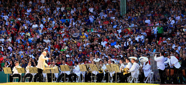 "BOSTON -- Renowned composer John Williams conducts the Boston Pops in the playing of his new composition ""Fanfare for Fenway"" during the special pregame ceremony celebrating the 100th anniversary of Fenway Park on Friday, April 20, 2012. (Brita Meng Outzen/Boston Red Sox)"